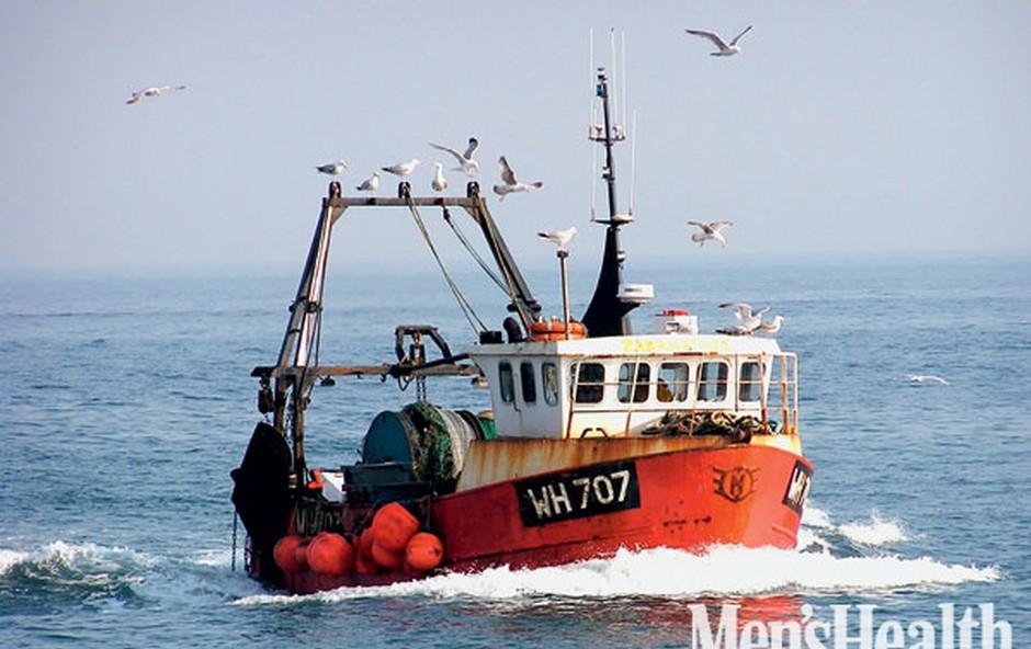 Moški, ženska, morje in riba (foto: Shutterstock.com)