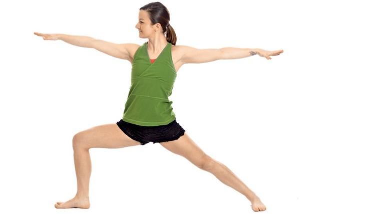 Jogijski položaj bojevnik - vaja, ki krepi in oblikuje telo   (foto: Shutterstock.com)